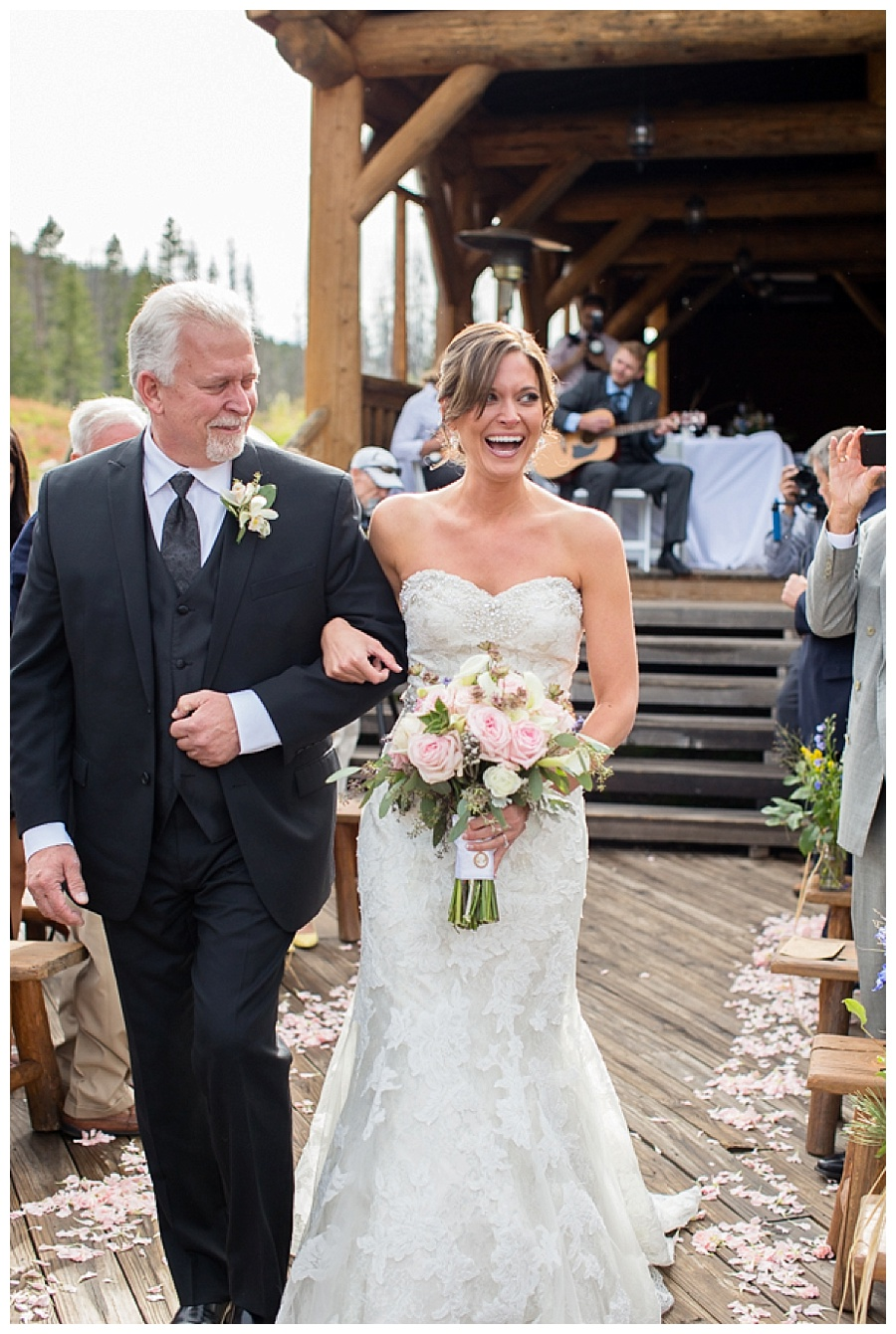 06 Bride walking down isle at Piney River Ranch