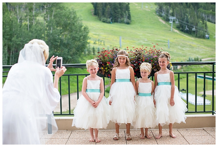 14 Bride taking photos of flower girls in Beaver Creek