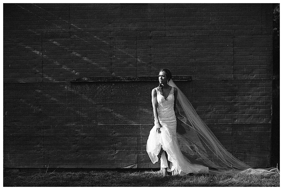 bride in front of old barn in Kansas