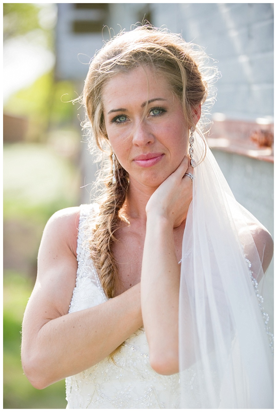 bride with long braid hairstyle