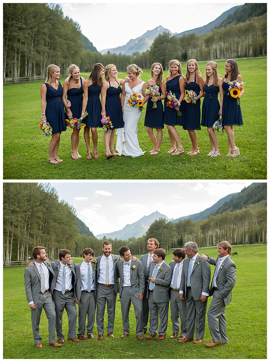 mountain shot of bridesmaids in navey blue and groomsmen in grey with mountain shot in Aspen CO
