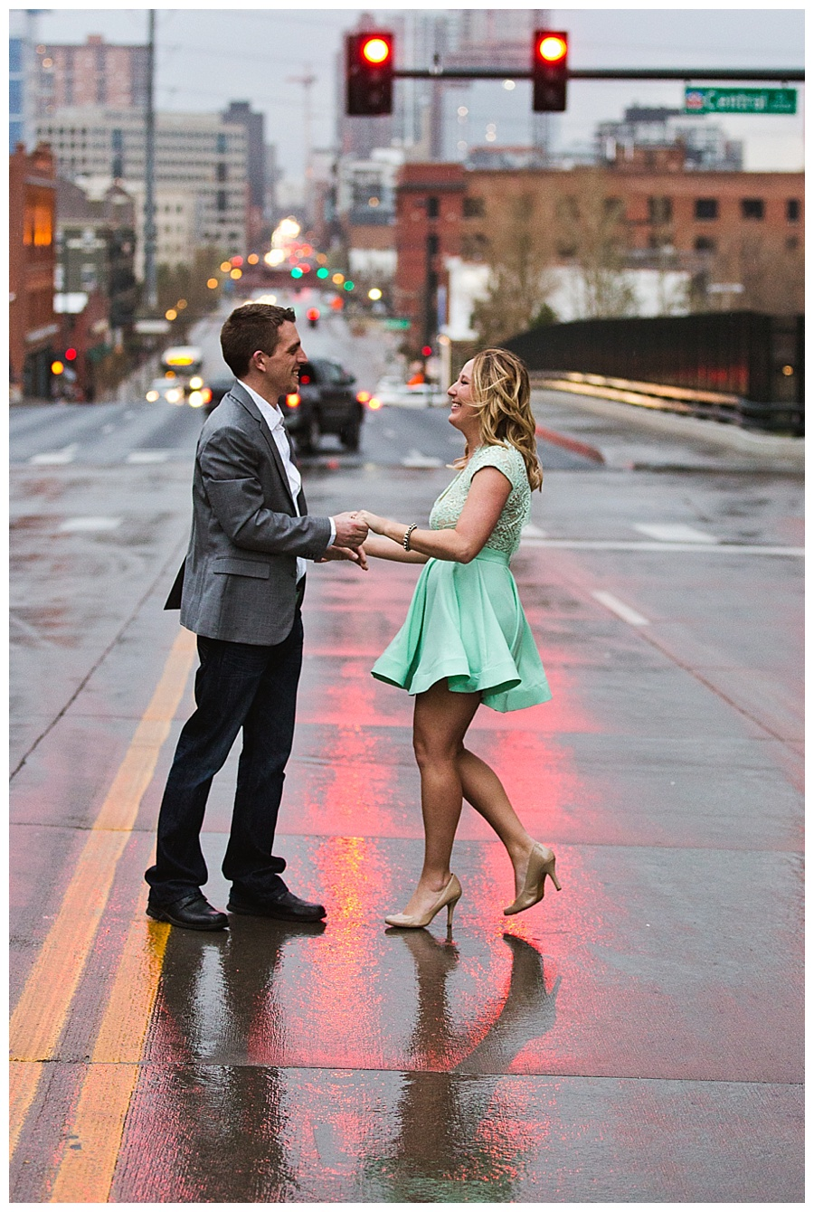 06 City engagement photos while dancing in the rain